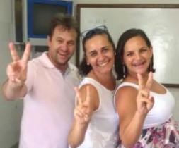 Simone Nascimento entre os víces Wagner Lopes e Catiane Mota.