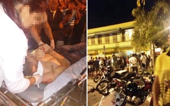 Um dos feridos sendo socorrido, na outra foto a boate que fica no primeiro andar